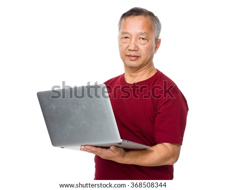Old man use of the laptop computer