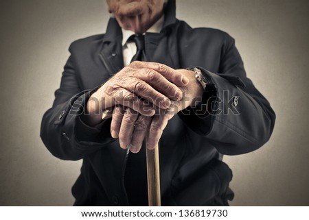 old man with a baton - stock photo