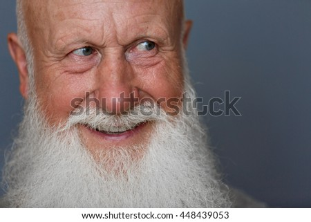 old man with a long beard on a blue background