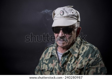 Old man with glasses and camouflage