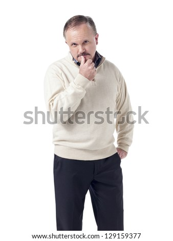 Old man with hand on his pocket and looking at the camera