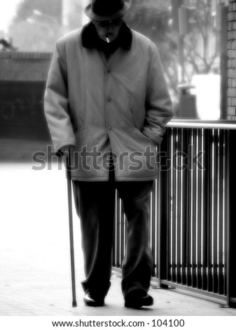 Old man with hat and stick - stock photo