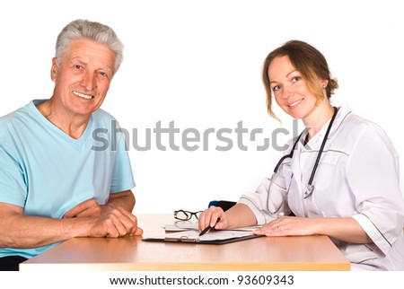old man with nurse sit at table on white