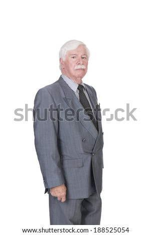 old man with silver white gray hair in a double breasted suit standing side ways looking at the camera on a white background in studio - stock photo