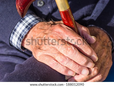 old man with stick - stock photo