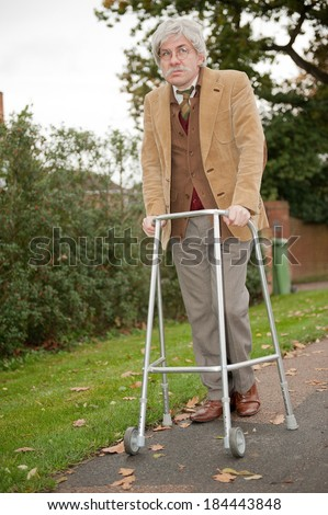 Old Man With Walking Aid - stock photo