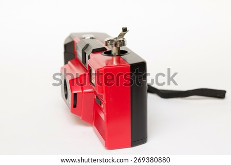 Old manual camera (Selective focus on knob for load 35mm film into a camera) - stock photo