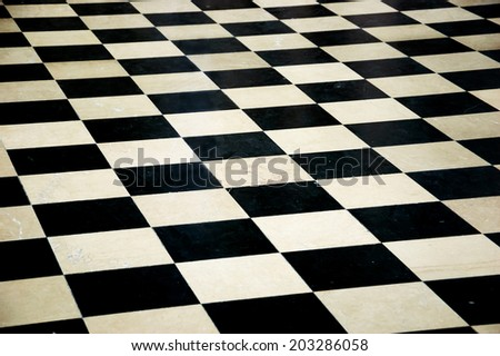 Old marble black and white tiles background. - stock photo