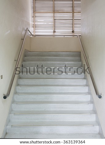Old marble staircase to the office building. - stock photo