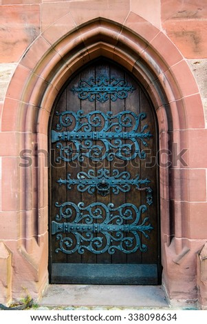 Old massive church door of the catholic church in Basel, Switzerland - stock photo