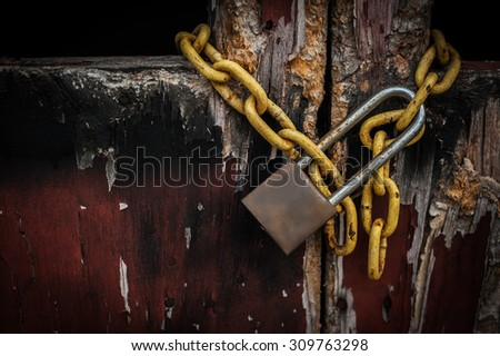 Old master key, Ghost lock door and shadow background, Selective focus - stock photo