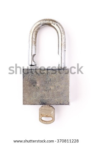 Old master key rusty and key lock on white background