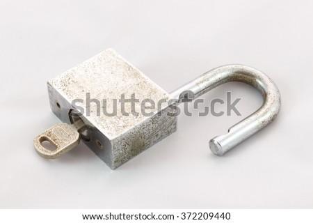 Old master key rusty and key lock on white background - stock photo