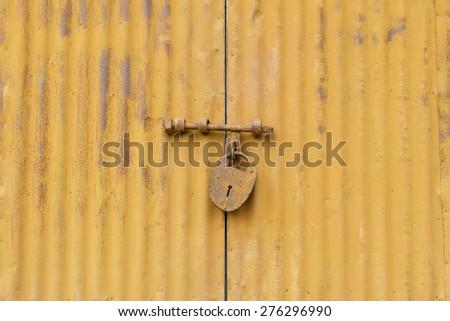 Old master key with steel door - stock photo