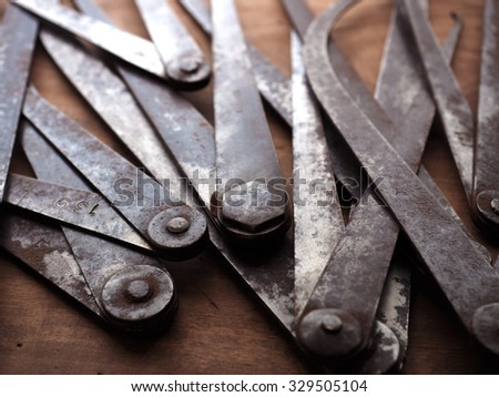 Old measuring Calipers, close up still life. Shallow depth of field. - stock photo