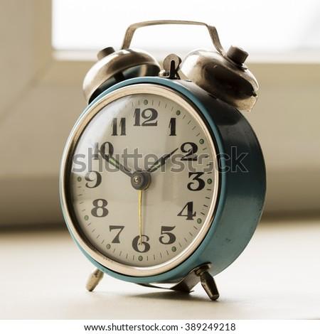 old mechanical alarm clock - stock photo