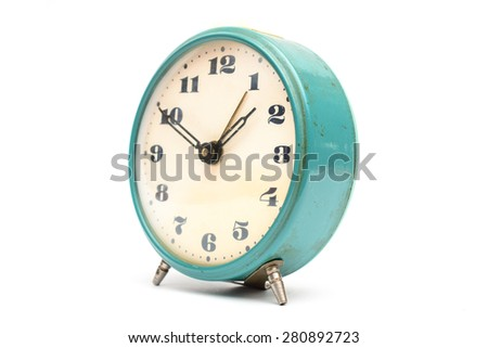 Old mechanical alarm clock on white background