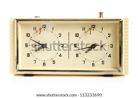 Old mechanical chess clock on a white background - stock photo