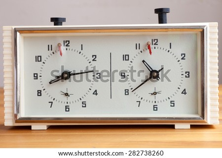 Old mechanical clock for chess - stock photo
