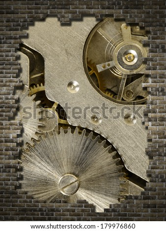 old mechanism on a broken wall - stock photo