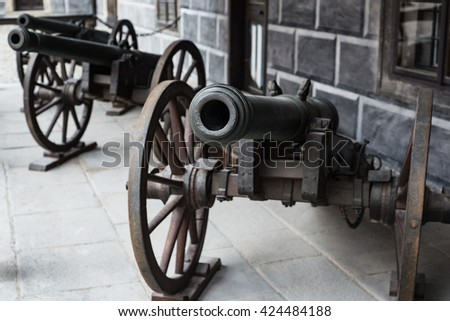 Old medieval cannon front view light artillery two