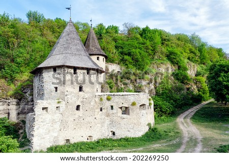 Old Medieval Castle (fortress) in Kamianets-Podilskyi, Ukraine - stock photo