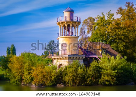 old medieval castle in vegetation near lake. Very colorful image