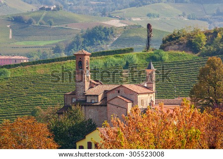 Old medieval church in small town of Barolo in Piedmont, Northern Italy. - stock photo