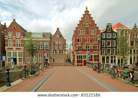 Old medieval facades in Amsterdam city center in the Netherlands - stock photo