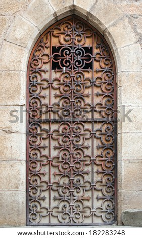 Old medieval rusty door with metal motif  in Rocamadour, France - stock photo