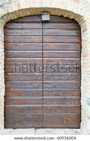 Old medieval style door in Florence, Italy