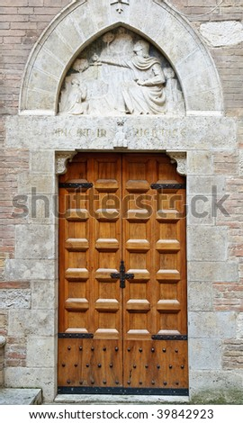 Old medieval style door in Siena, Italy