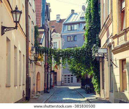 Old medieval summer street in Riga, Latvia. - stock photo