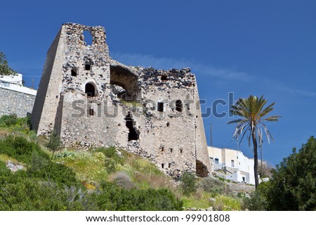 Old medieval tower at Emporio village of Santorini island in Greece - stock photo