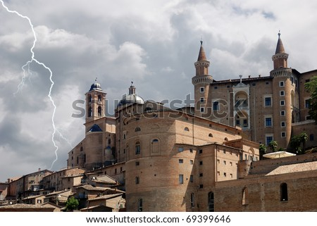 old medieval town  under cloudy sky - stock photo