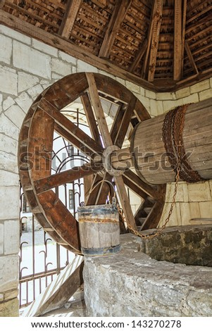 Old medieval water well - stock photo