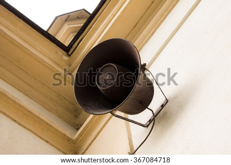 Old megaphone on building - stock photo