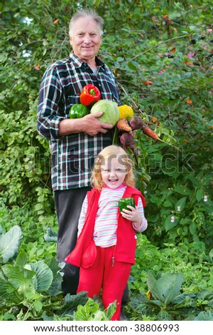 old men and girl in garden