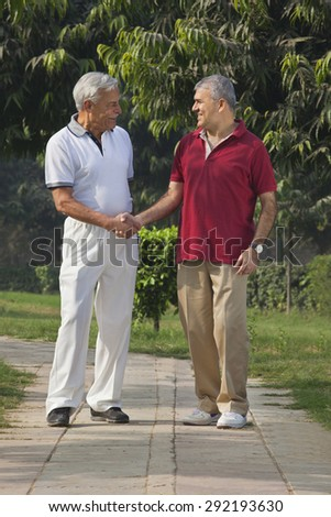 Old men shaking hands