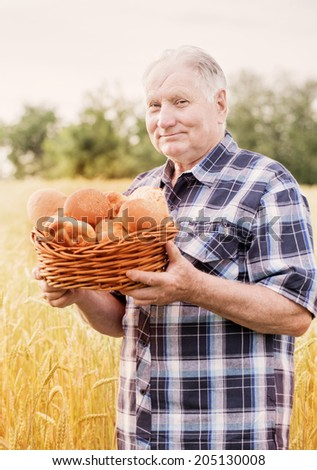 old men standing in fields - stock photo