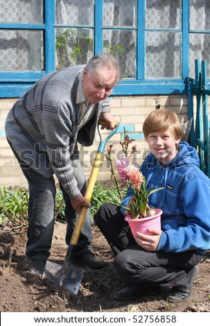 old men with boy in garden - stock photo