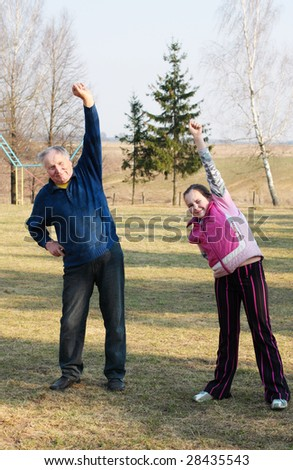 old men with girl outdoor