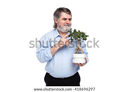 old men with gray beard holding a small tree in hand, isolated on white