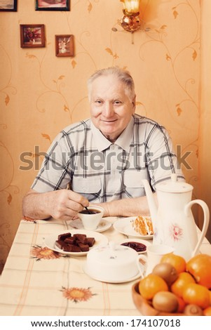 old men with tea in kitchen - stock photo