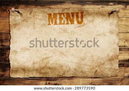 old menu card nailed on a wooden wall - stock photo