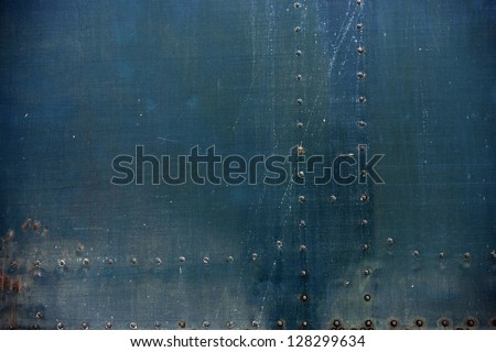 Old Metal Background with Bolt Heads. Grunge Metallic Background. - stock photo