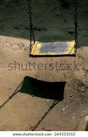 Old metal childrens swing metal textures and patterns - stock photo