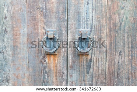 Old metal door handle knocker. - stock photo