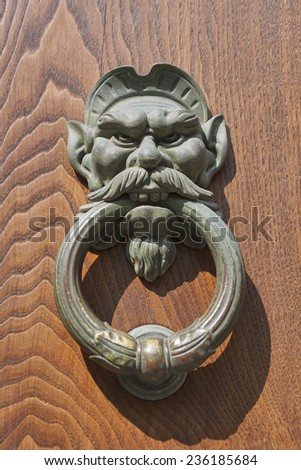Old metal door knocker closeup - stock photo