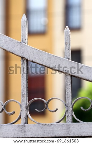 Old metal fence, private property protection.